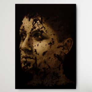 Portrait of a young man with rotten skin staring into the nothingsness on dark ground