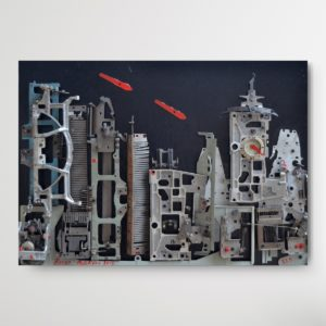 Broken pieces of old typing machine arranged as a skyline on a canvas on dark blue background hanging at a wall