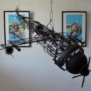 Iron wired object looking like a propeller plane hanging in the studio of Romeo Melikyan